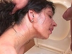 Lewd pissing wench kinked up on the crapper