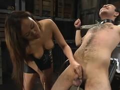 Oriental hussy Annie Cruz enjoys torturing Sir C in a basement