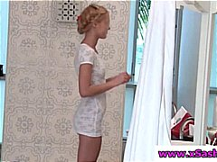 Slender blond legal age teenager is in the washroom shaving her little slit