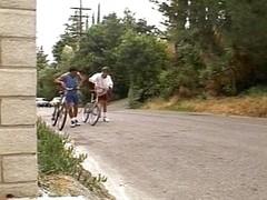 Breasty swarthy biker drilled by 2 schlongs